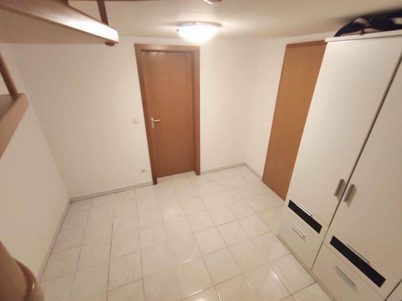 Blick von der Wendeltreppe zum Badezimmer
